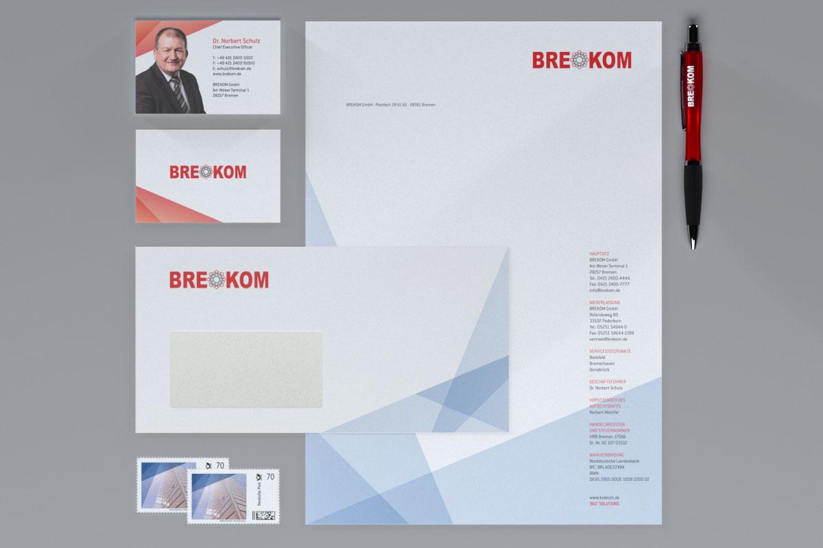 Visitenkarte, Briefumschlag, Briefmarken, Briefbogen, Kugelschreiber im BREKOM-Design