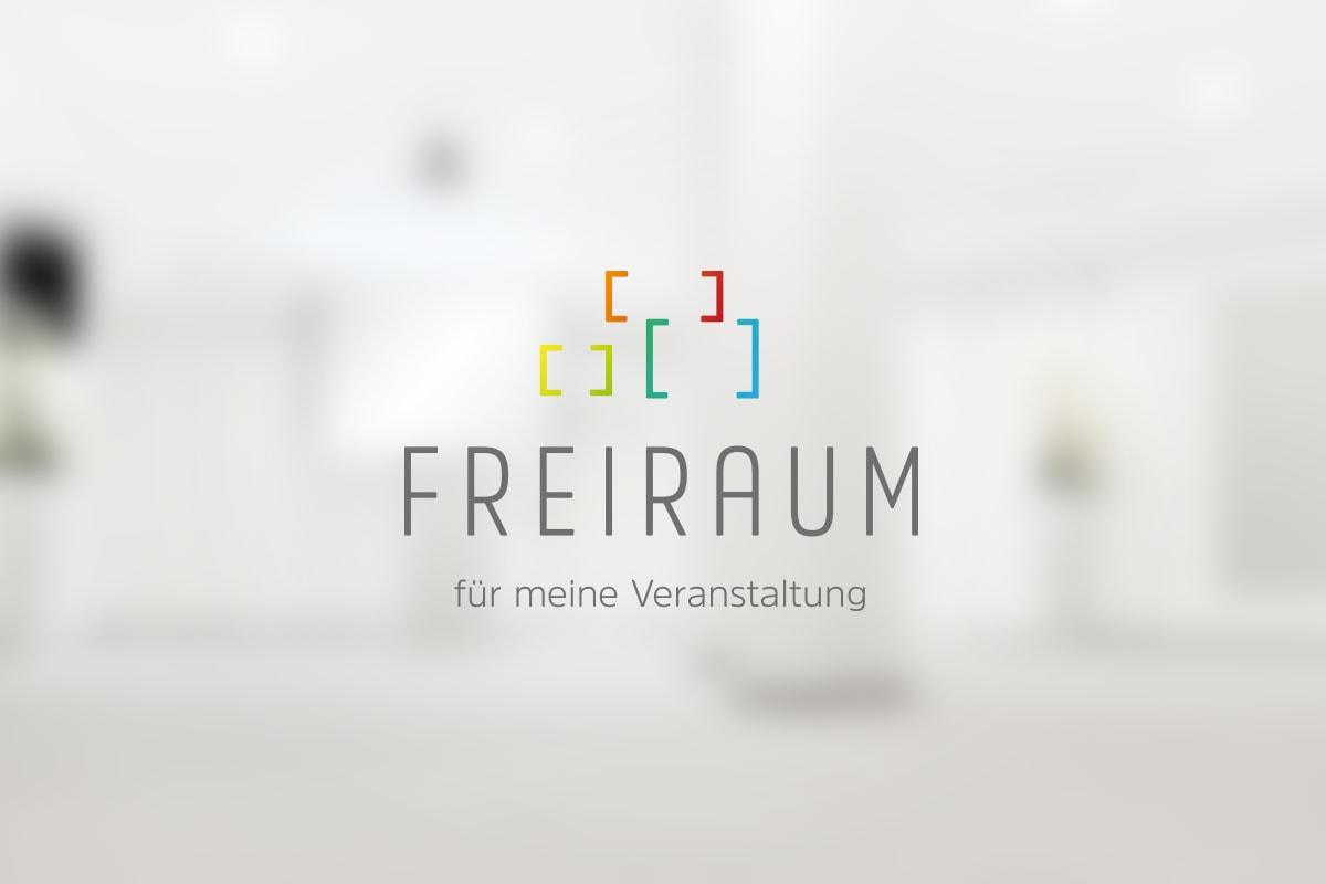Freiraum-Logo auf unscharfem Untergrund