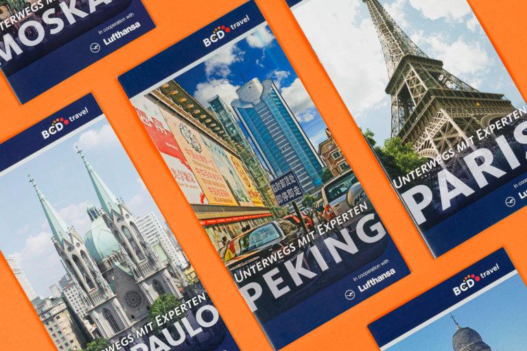 Eine Collage aus Reiseführern für BCD Travel